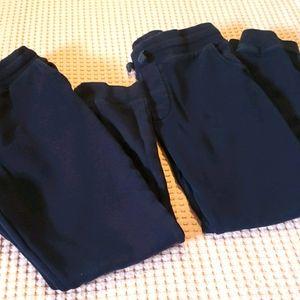 Two boy's school uniform pant.